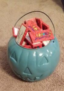 Teal pumpkin with crayons
