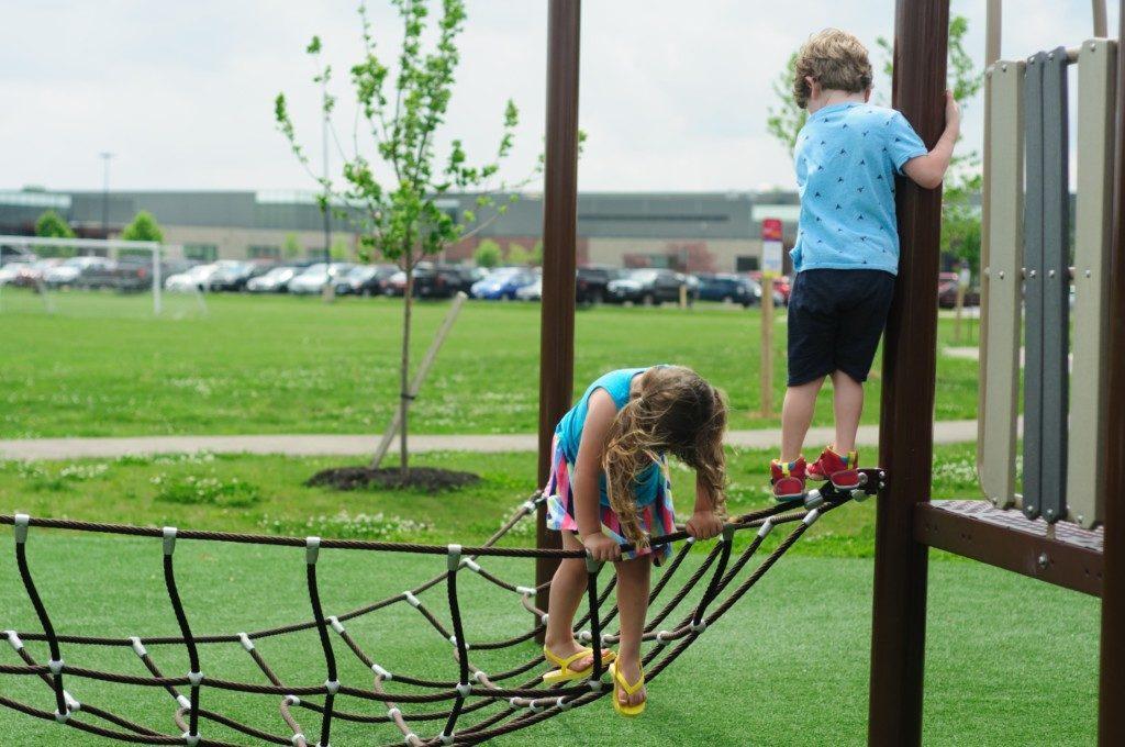 children climbing on rope net at playground