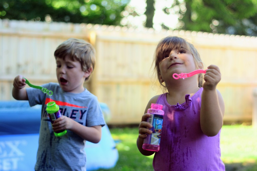 children at play outside with bubbles