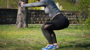 Woman squatting for pelvic floor PT