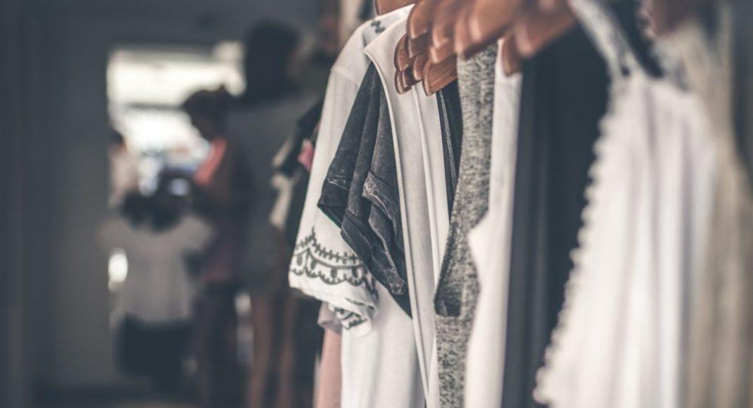 Wardrobe staples hanging in closet