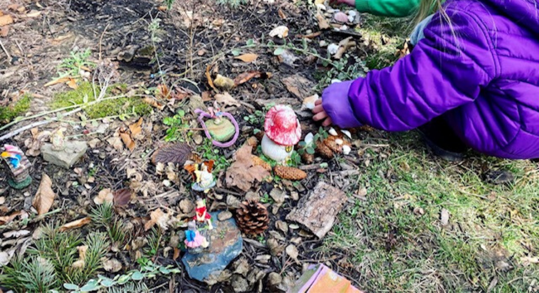 playing in a fairy garden